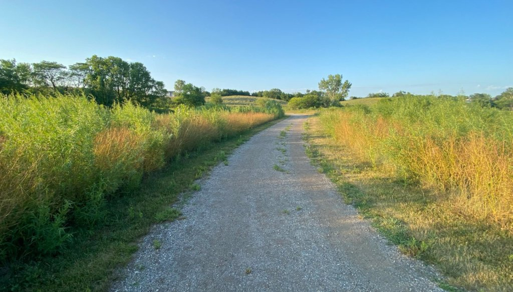 a secondary gravel ada hayden trail leading to wetlands and prairie areas