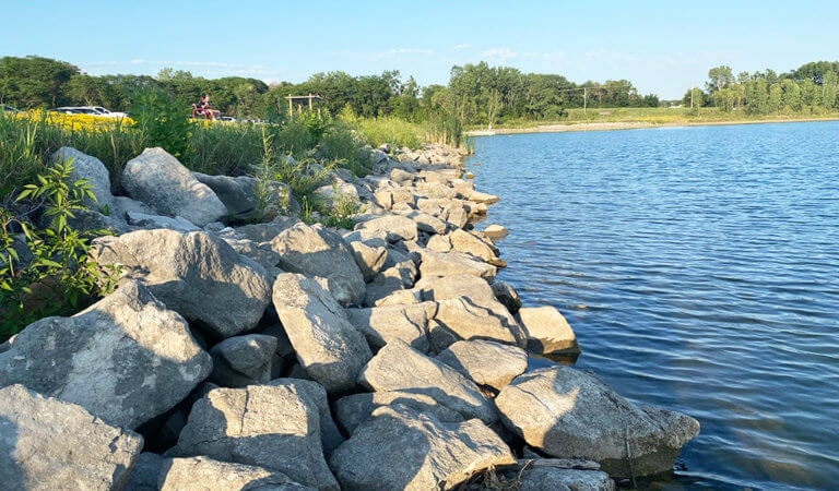 large rocks alongside ada hayden lake shoreline