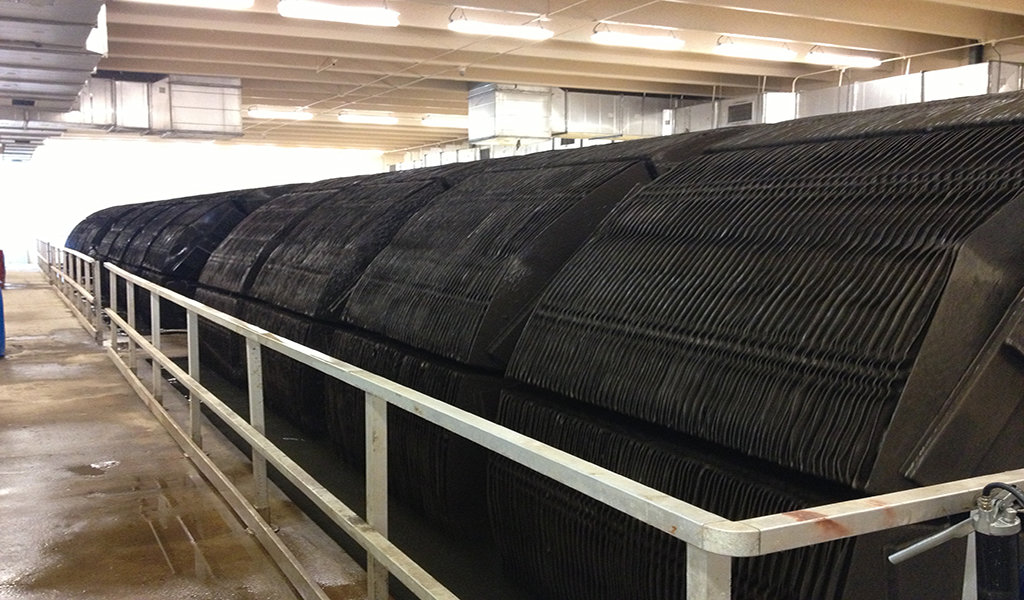 row of black cylindrical rotating biological contactors