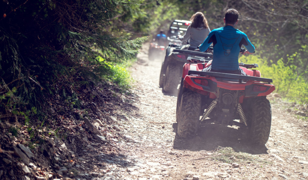 man riding atv vehicle on off road track ,people outdoor sport activities theme