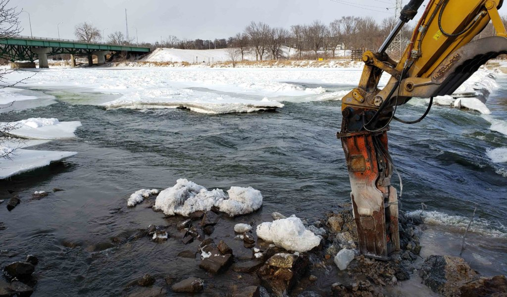 Dam demolition occuring in ice covered Des Moines river