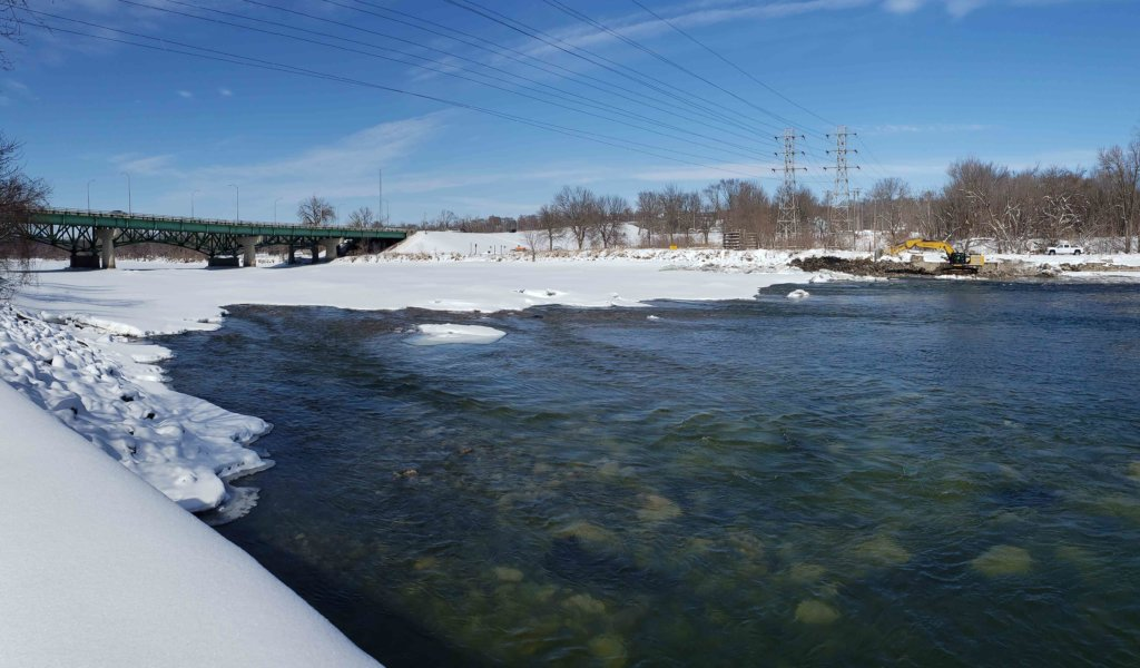Snow covered Des Moines river after recently completed demolition of Little Dam