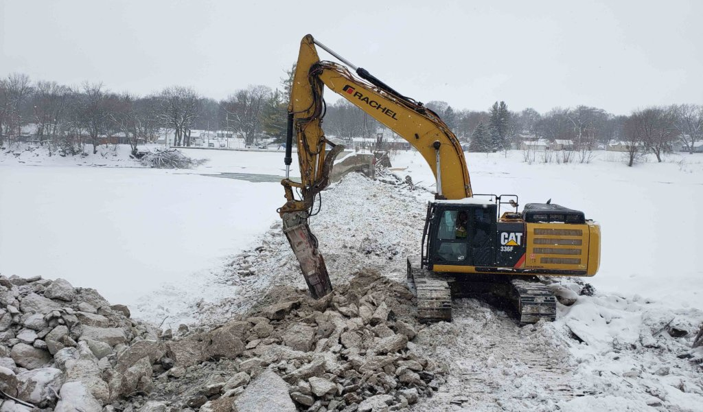 In progress demolition of Hydroelectric on snow covered Des Moines river
