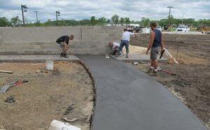 Construction crew installing pavement