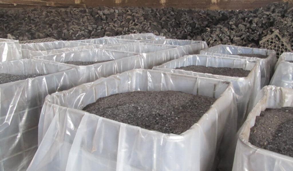 Large bins full of plastic medium for filtering