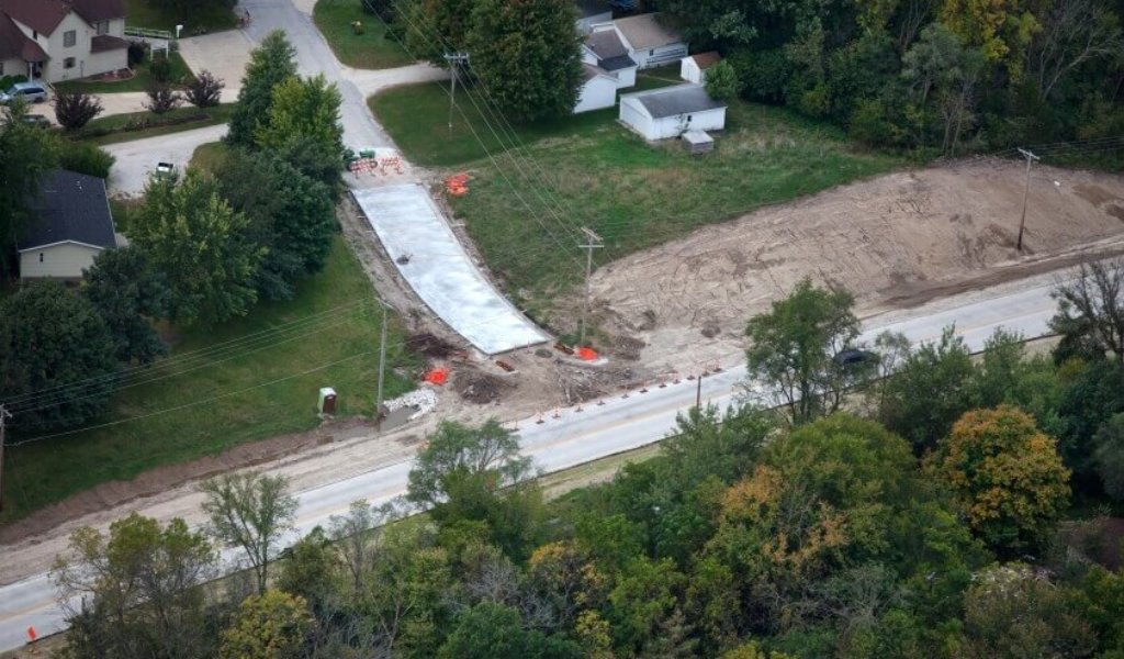 Aerial view of a residential to roadway construction zone.