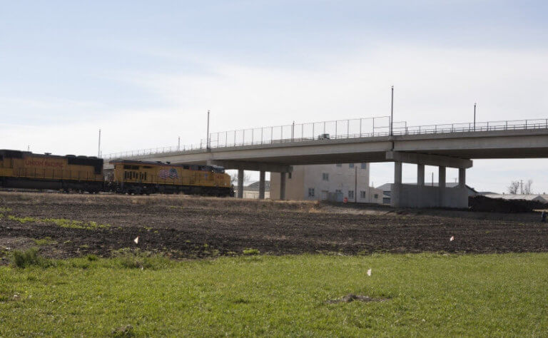 Union Pacific train approaching overpass in Jefferson Iowa.
