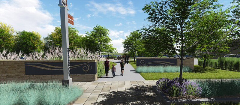 Rendering of a paved walkway with directional signage and landscaping