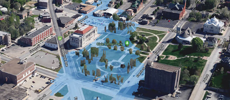 Aerial rendering of a city, showcasing, in blue, the floodplain area.