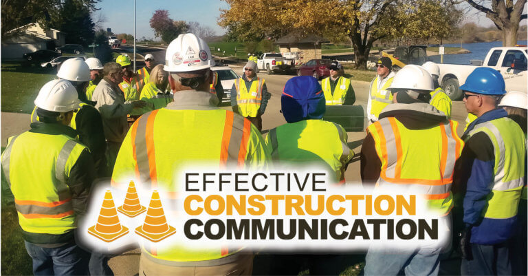 effective construction communication graphic superimposed over a group of construction workers meeting on site