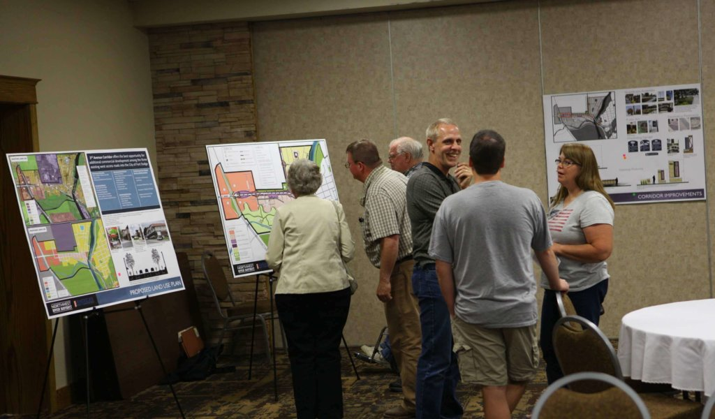 Community members attending informative meeting about Northwest River District in conference room.