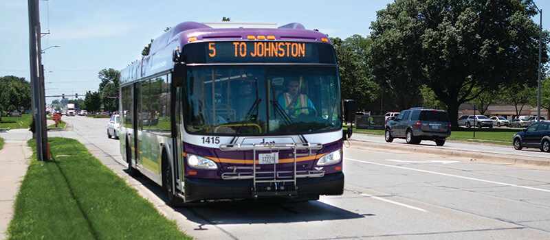 A commuter bus on its route, contributing to the vitality of a community transit system.