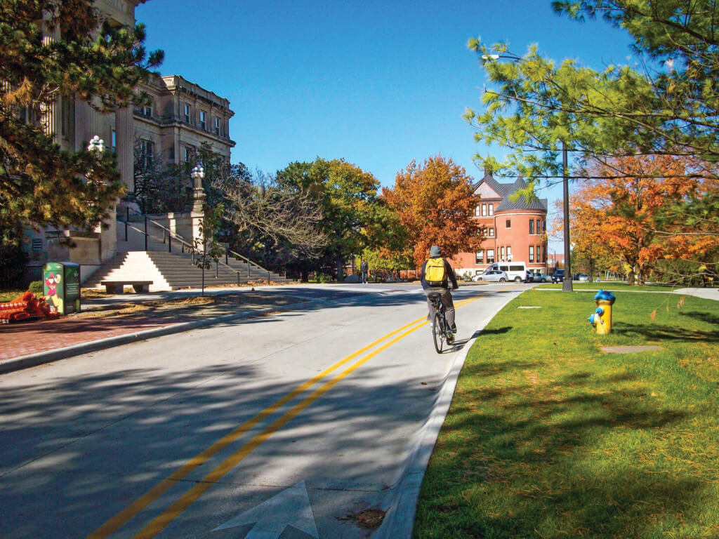 cyclist traveling in a contra-flow bike lane at ISU Morrill Lane