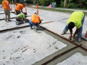 workers smooth new concrete