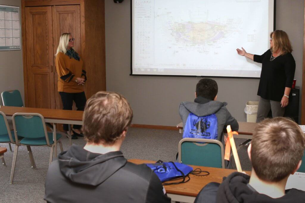 Civil engineering technicians Jessica Sundquist and Katie Wade, with Snyder & Associates, a civil engineering firm, speak to a room of 8th-12th grade students during DMACC Career Discover Days.