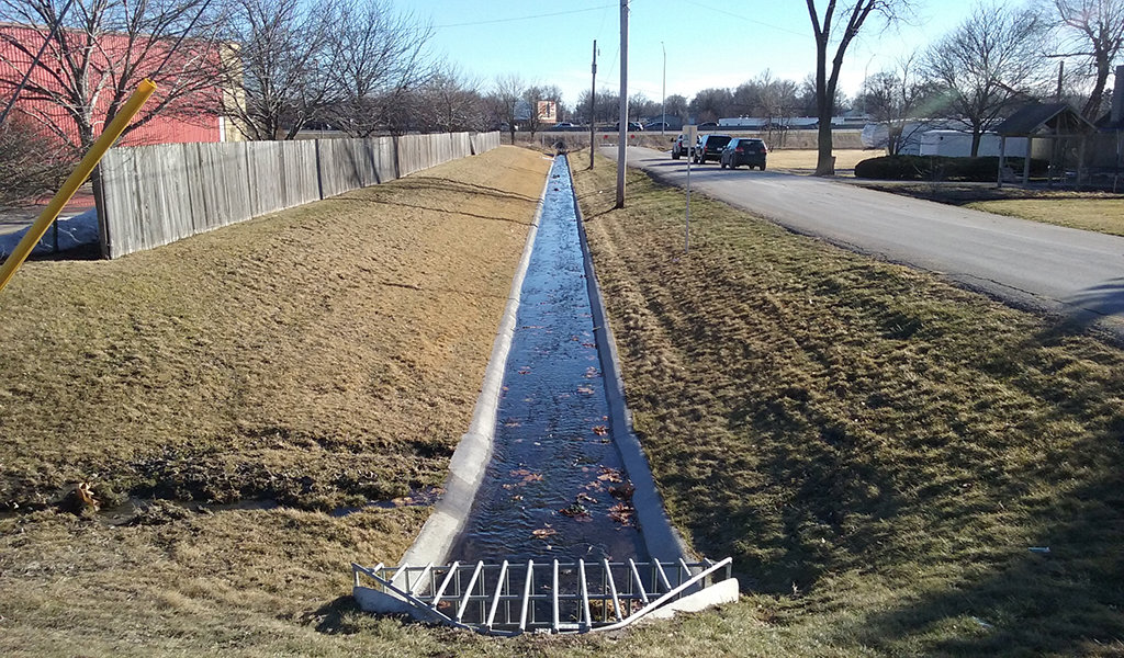 a strip of stormwater infrastructure parallel to the road