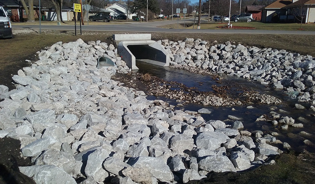 a new box culvert with riprap rock along the edges