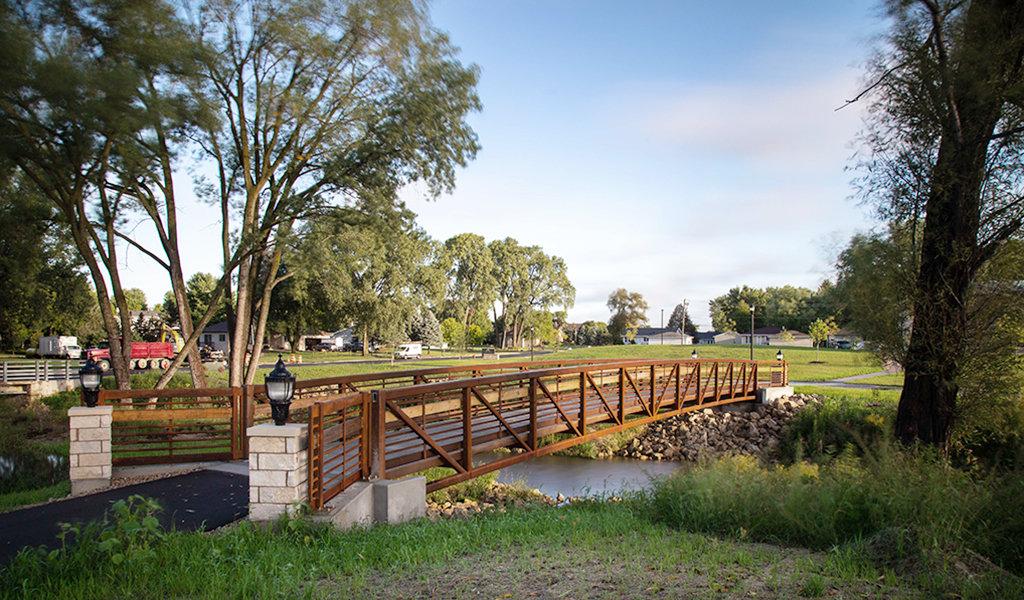 Pedestrian bridge connecting public library lawns.
