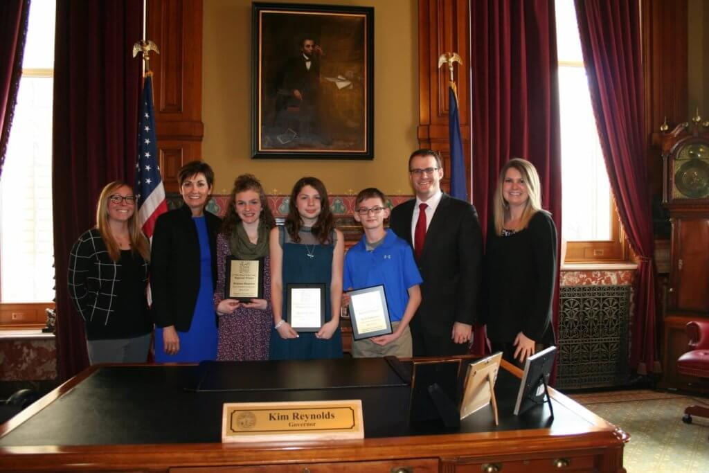 Winners of the 2017 If I Were Mayor Essay Contest are honored at the Iowa Capitol building in Des Moines.