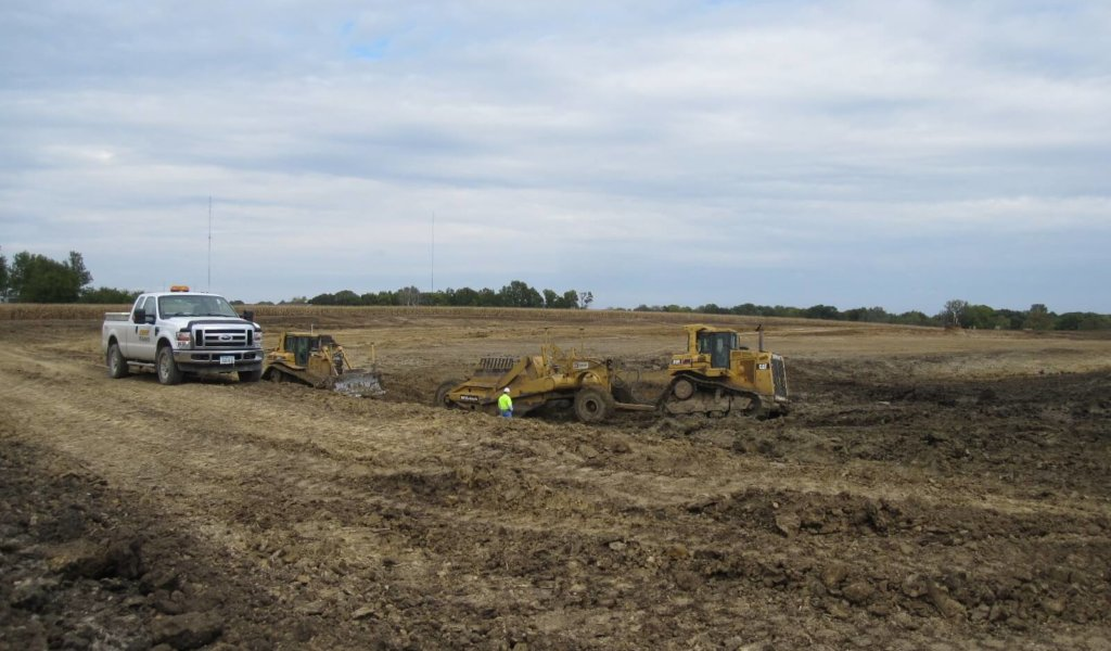 A photo showing earthwork taking place for the construction of a controlled discharge lagoon.