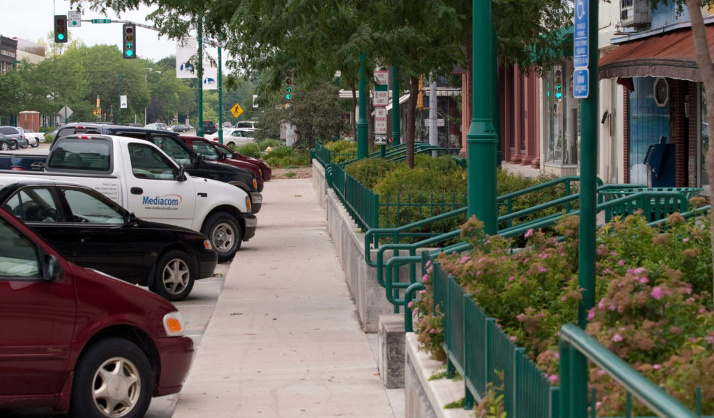The Clinton streetscape design capitalizes on a change in elevation to improve multimodal access with steps and ada-compliant ramps.