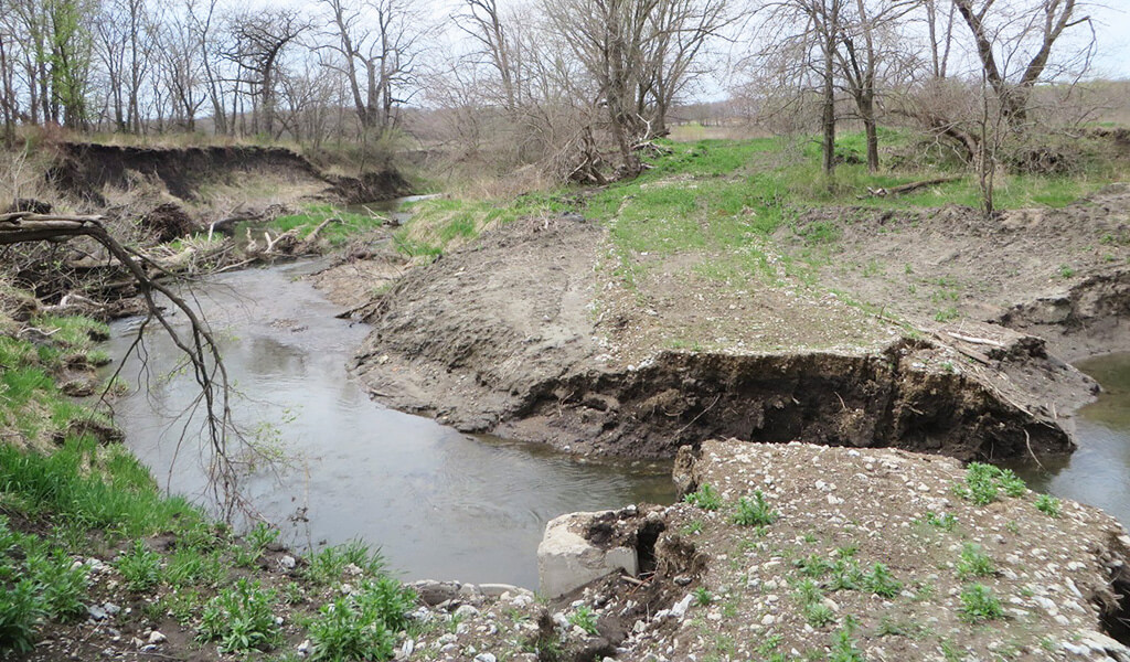 Severe stream bank erosion of Sugar Creek was observed prior to project construction to realign the creek.