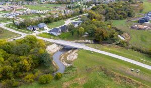 An aerial view of a new bridge over a realigned segment of Sugar Creek in West Des Moines.