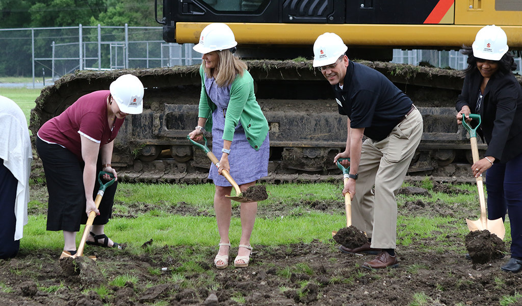 Officials dig ceremonial ground breaking