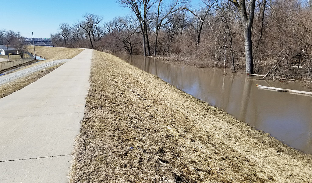 floodwaters along walking trail