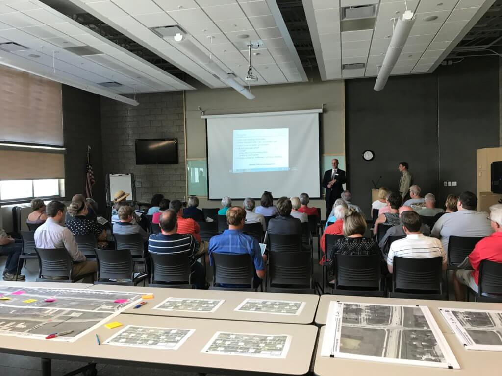 People gather for public engagement presentation