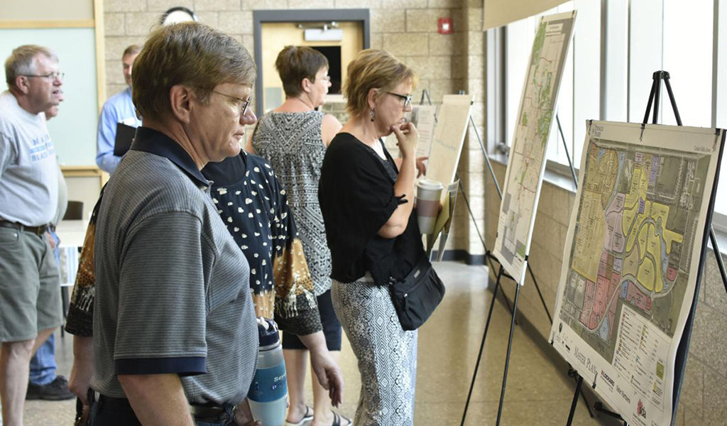 community members viewing proposed plans