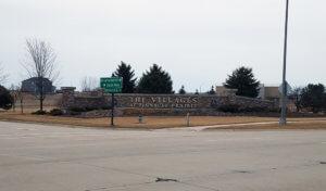Large stone neighborhood sign