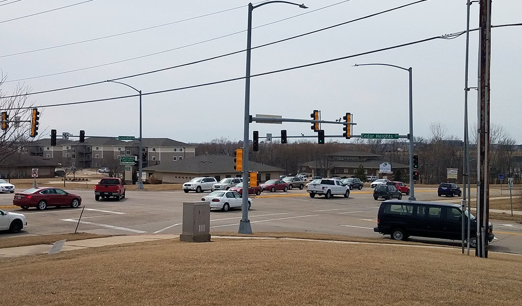 cars moving through a busy intersection
