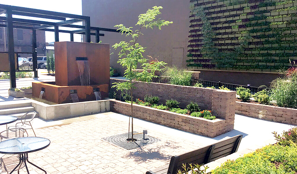 pocket park seating area surrounded by plants