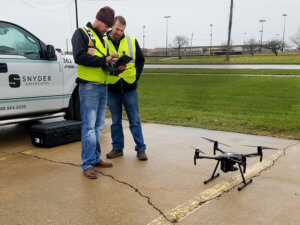 two snyder employees getting ready for drone flight