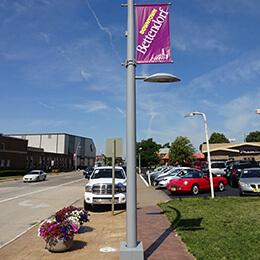 Street lightpole with purple welcome banner