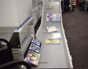 machine separating books on a conveyor belt