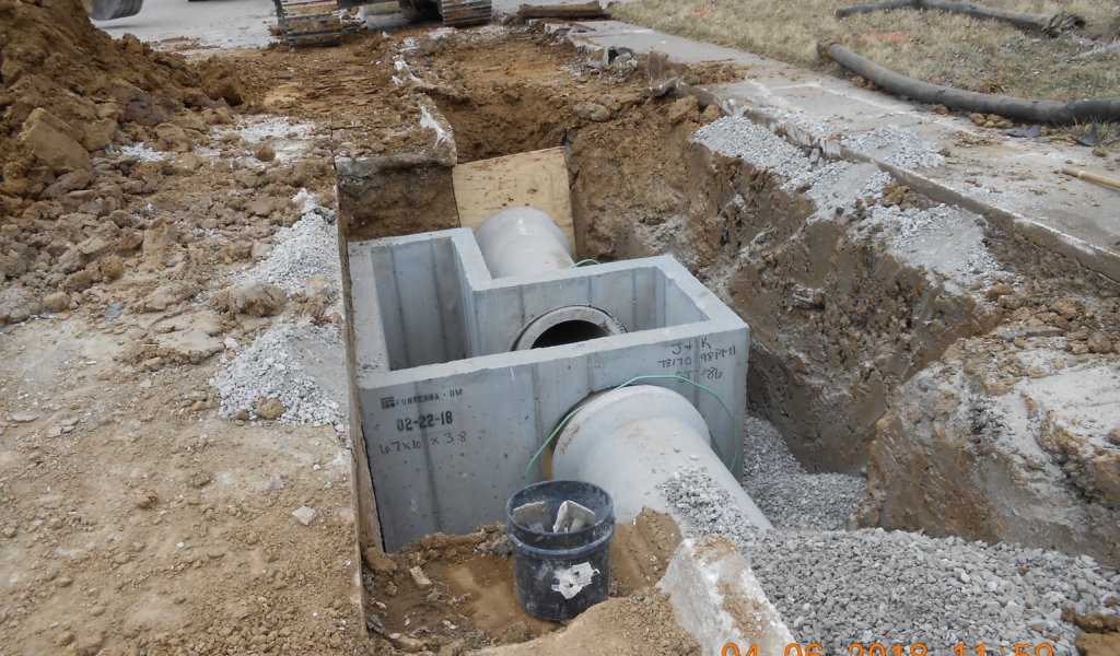 Exposed storm sewer intake.