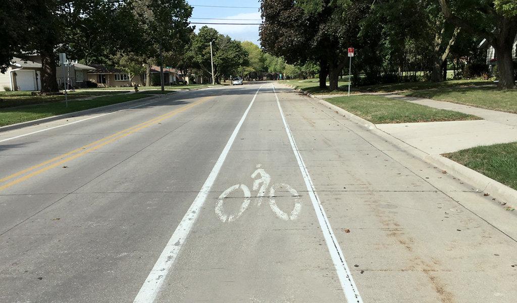 narrow lane on roadway designated for bikes