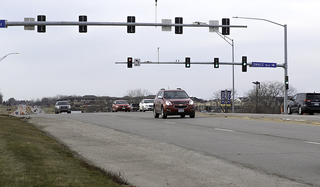 cars driving through an intersection