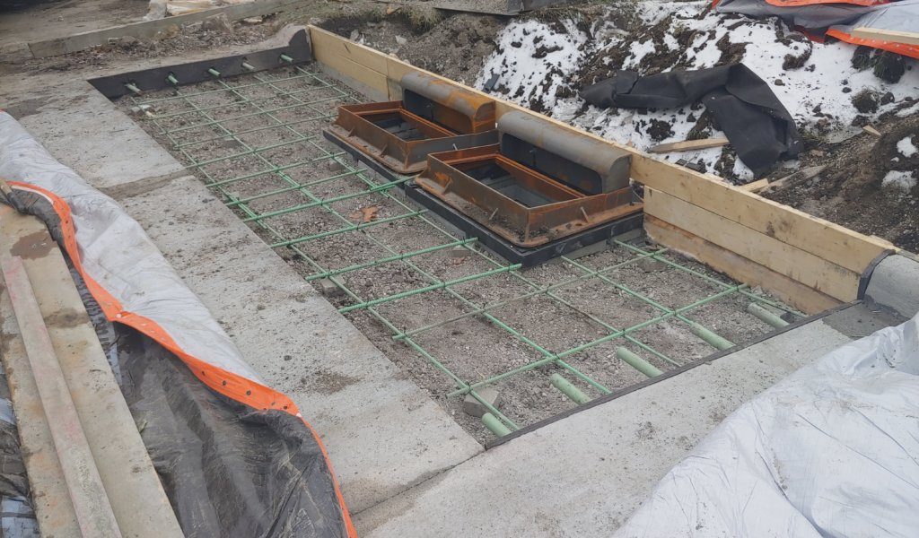 two metal stormwater inlets before concrete is added around them