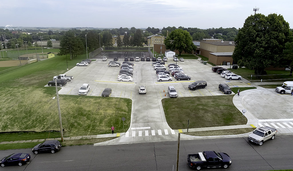 view looking down on new parking lot filled with cars