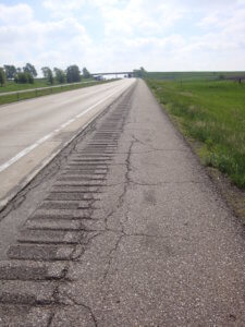 cracked rumble strip along roadway