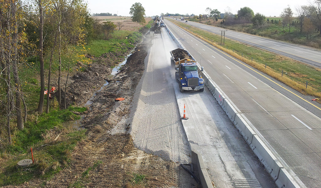 construction of extended roadway shoulders and drainage ditches