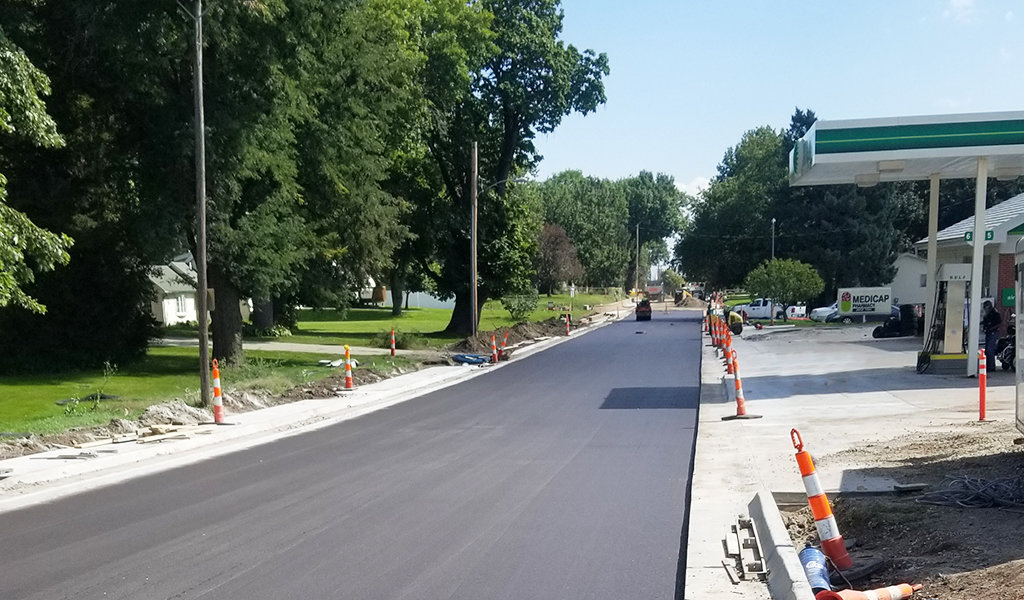 view of newly paved roadway next to gas station