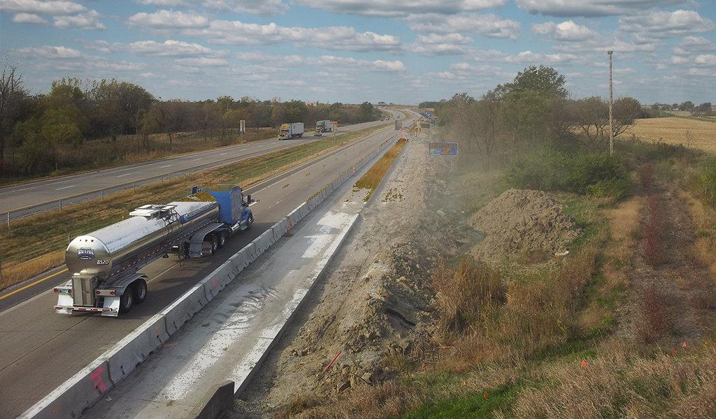 semi-truck driving on a new roadway