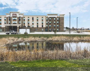 Hampton Inn front with small pond