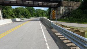 road passing under a railroad bridge