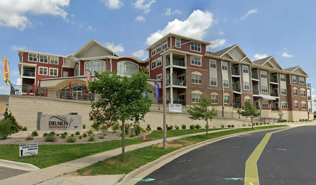 Large brick apartment building on a hill