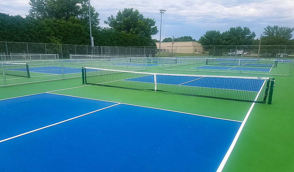 close up view of blue and green tennis courts
